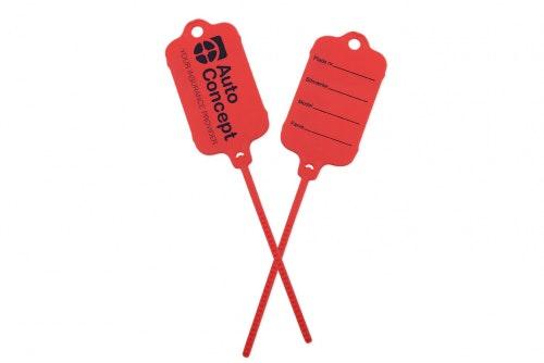Keytag punainen, molemmilla puolilla oma painatus